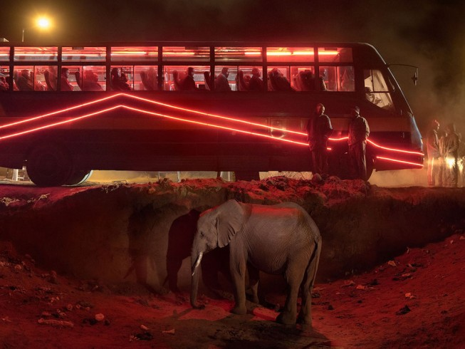 BUS STATION WITH ELEPHANT & RED BUS